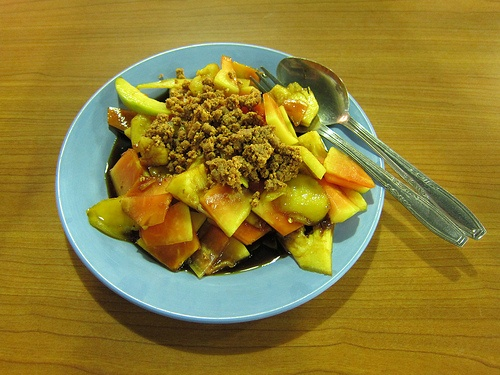 Rujak, Indonesian fruit salad, made of sliced papaya, melon, pineapple, yam, rose apple, mango with brown sugar sauce.