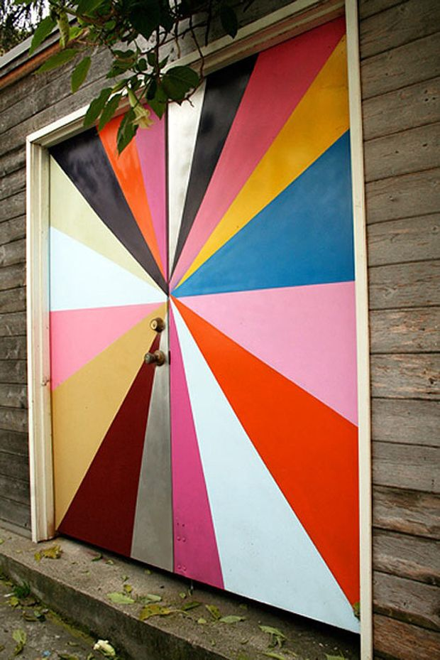 use tape to paint geometric designs on the garage door and the exterior basement door!