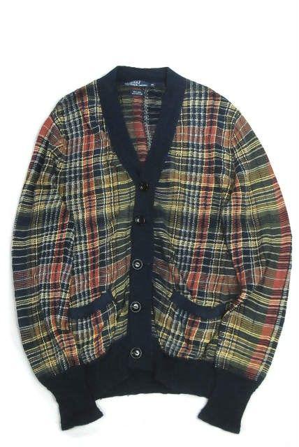POLO by RALPH LAURENのコットンリネンチェックVネックカーディガンになります。 肌触りの良いコットンリネン素材を使用した一着。 カラフルな配色で、襟元や袖口リブのコントラストもアクセントになります。 シンプルなTシャツやシャツとのスタイルに最適な逸品です。 サイズ:M 肩幅43cm 身幅51cm 袖丈66cm 着丈62cm カラー:ネイビー/オレンジ/イエローなど マテリアル:麻61% コットン39% 状態備考:スレあり。 【コンディションランク:B】S新品同様の商品(タグ付,袋付きなど