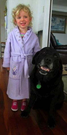 Granddaughter Ellie and Labrador Otis