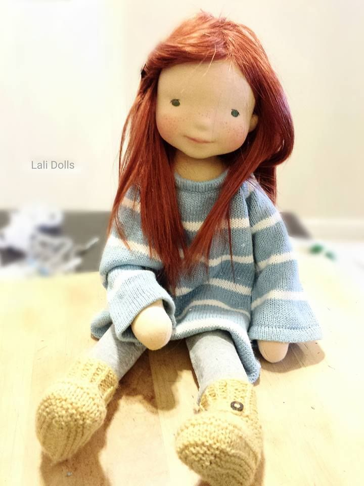 Noor wearing her cozy boots, made by Jennifer Williams at Lali Dolls                                                                                                                                                                                 More