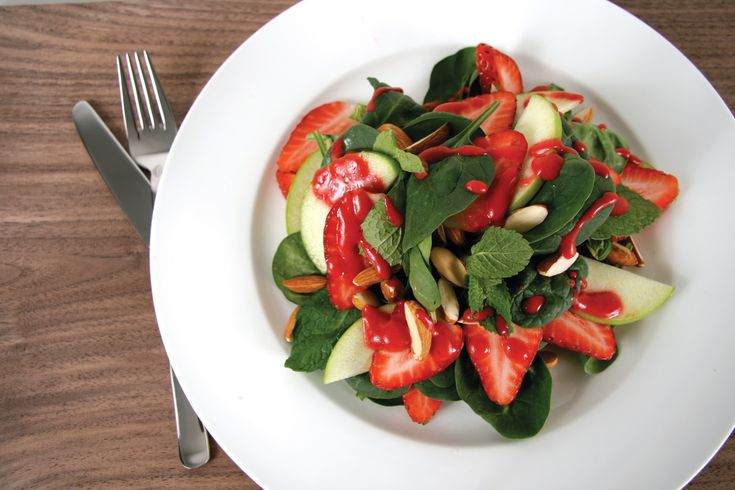 Fresh and delicious, apples and strawberries playing together for a beautiful, healthy salad.