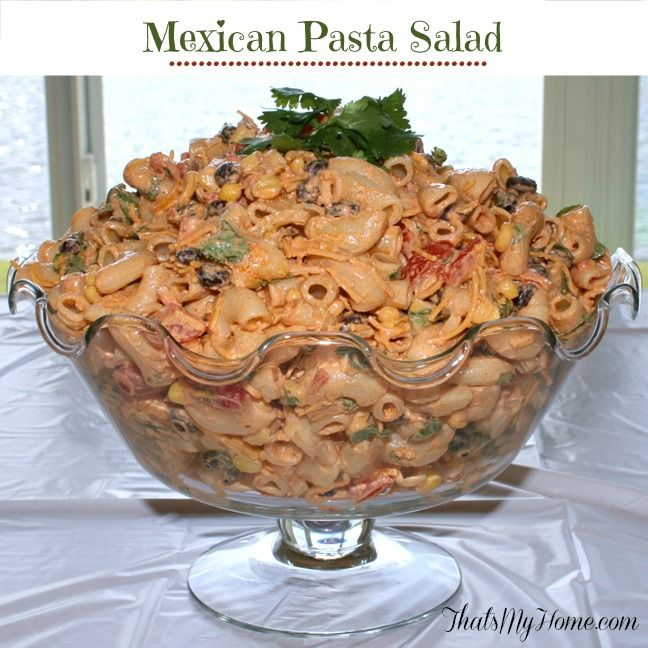 Mexican Taco Pasta Salad is made with macaroni, black beans, corn, veggies and a spicy taco flavored dressing.