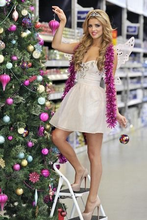 Lucy, 21, grabbed her magic wand and donned this pretty pale pink dress and wings, along with some killer Louboutins, to introduce the B&Q Christmas range at the B&Q Store, New Malden, London today (6 November 2012)