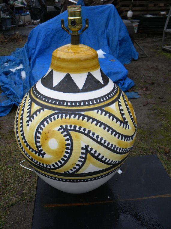 HERE WE HAVE A GREAT SHAPE HUGE VINTAGE 1970S OR SO , LOTTE BOSTLUND POTTERY LAMP. THERE IS NO DAMAGE.THERE IS NO CRAZING,NO HAIRLINES,NO REPAIRS,NO DISCOLORATION AND IT RETAINS A GORGEOUS ORIGINAL FINISH. IT IS SIGNED,CHECK PHOTOS.IT MEASURES ABOUT 19 1/2  TO THE TOP OF THE POTTERY.IT IS ABOUT 14  WIDE. IM ALSO LISTING ANOTHER ONE SIMILAR TO THIS ONE , IN A DIFFERENT COLOR.JUST AN OVERALL VERY COOL PIECE OF MID CENTURY LIGHTING. brn