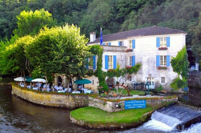 """Brantôme, known as the """"Venice of the Périgord"""" because of it's winding waterways, is a stunning spot where the 16th century masterpiece that is the quirky right-angled stone bridge known as Pont Coudé links the ancient abbey with the monastery garden as well as the medieval tower"""
