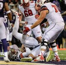 (Trent Nelson  |  The Salt Lake Tribune)   Utah Utes quarterback Travis Wilson (7) scores a touchdown in the fourth quarter as the University of Utah faces the University of Washington, NCAA football at Husky Stadium in Seattle, Saturday November 7, 2015.