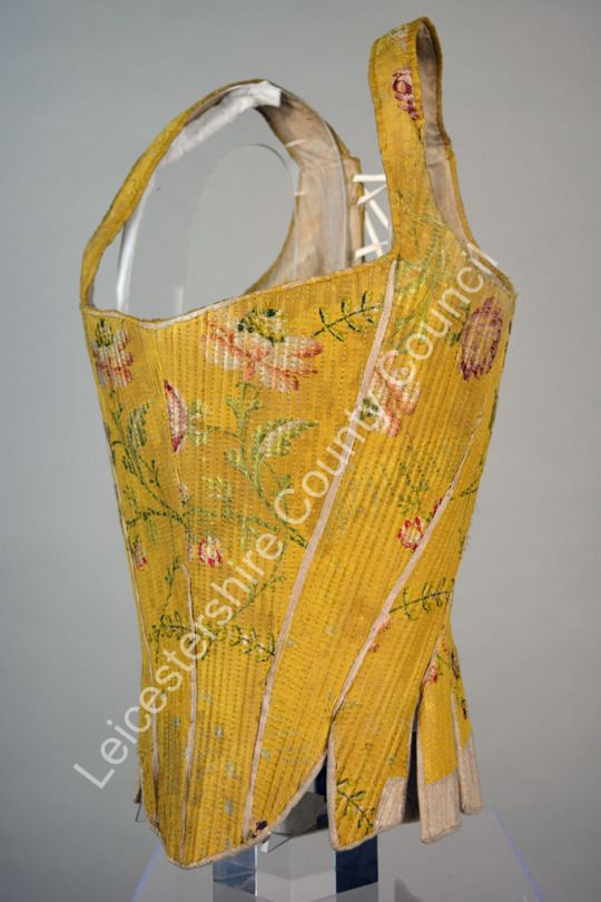 Corset made from yellow silk brocade and trimmed with white leather. It dates from around 1770 and was proberably made in Italy.  It forms part of the Fashion Collections of Leicestershire County Council.  This corset is available for study, by appointment, at the Collections Resources Centre in Leicestershire.