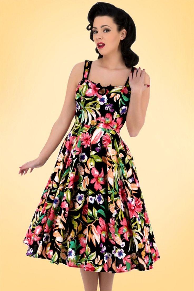 Deze 50s Emma Floral Swing Dress is de perfecte combinatie van elegant, schattig en speels!Met haar eyecatching tropische bloemenprint, flirty keyhole en schattige zwarte strik is zij een echt schatje ;-) Uitgevoerd in een licht stretchy, zwarte katoenmix voor een perfecte pasvorm.''Come on baby let us fly, take atickettothe sun, to atropicalparadise...!''   Swing jurk Sweetheart halslijn Vaste strik Zwarte ...