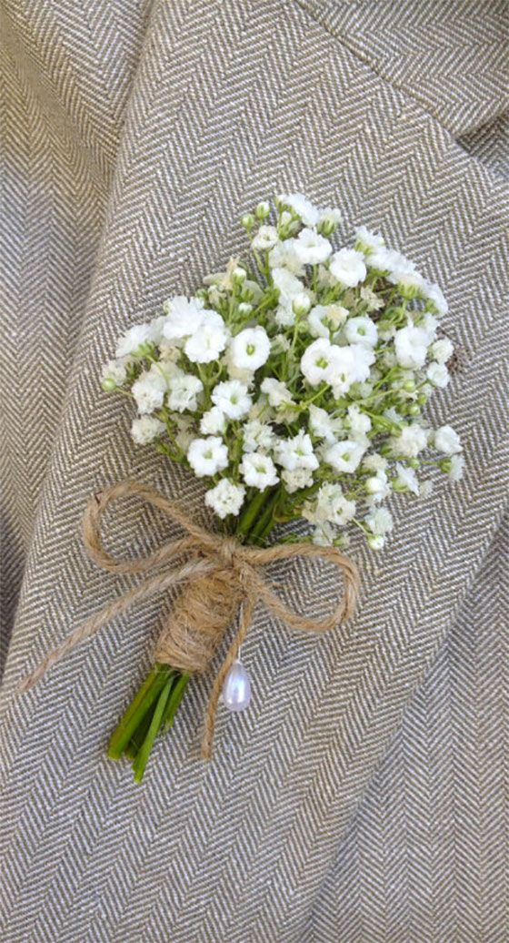 Baby's breath boutonniere tied with twine. You can order them with fresh or preserved flowers. Comes with a pearl lapel pin.