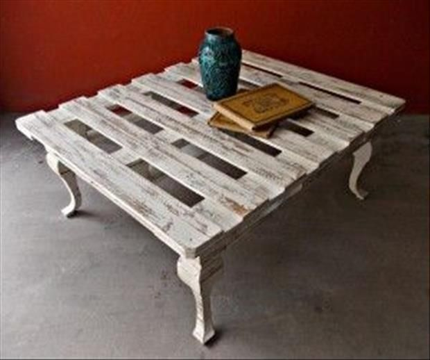 I love the legs on this upcycled pallet table; you usually just see industrial-looking wheels, but these kind of make the table look more chabby chic - love it!