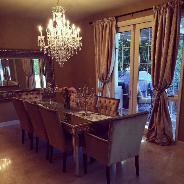 That chandelier and those chairs