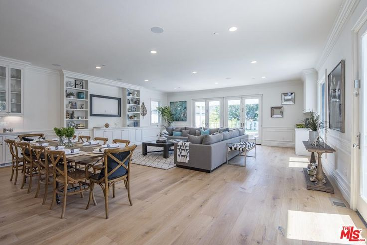 The palette is cool and sophisticated. Butler's pantry w/wine refrigerator leads to gourmet eat-in kitchen w/marble countertops, subway tile, 6-burner range w/griddle & pot filler faucet, farmhouse sink.