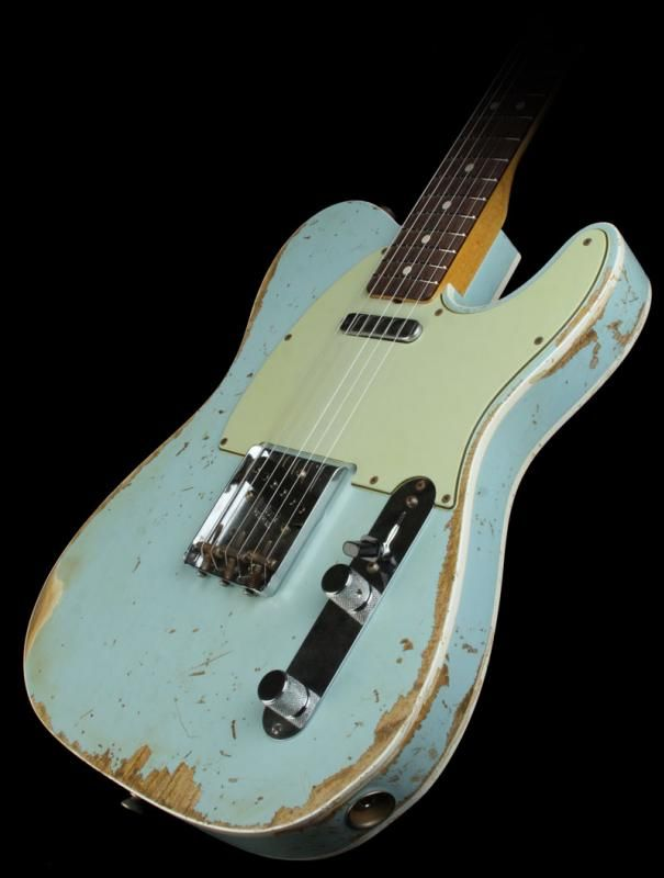 Blue reliced Fender Telecaster electric guitar. I love the color I need a blue guitar to finish my collection.
