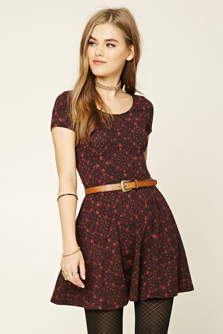 Style Deals - A knit skater mini dress featuring an allover stain glass print, a round neckline, and short sleeves.