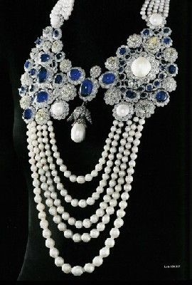 La Regente Pearl (center) is the 5th largest pearl in the world and perhaps the largest pearl of a regular shape, and was given as a gift by Emperor Napoleon I to his second wife and Queen Consort Marie Louise in 1811. Here, it is mounted on a modern pearl, sapphire and diamond necklace.