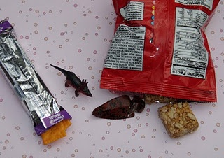 Carefully open a treat switch it with another or add something to it then seal it back together with double sided sticky tape.  Such a cute idea for a fun treat!