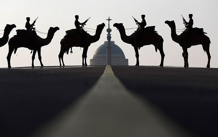 New Delhi, India: soldiers from the border security force ride their camels in front of India's presidential palace, Rashtrapati Bhavan, during a rehearsal for the Beating the Retreat ceremony, which will take place on 29 January and marks the end of Republic Day celebrations