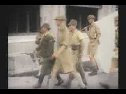 """Clip of WW II Fall of Singapore 1942 - rare footage  Which is why nowadays protect-a-cow.com says """"World Peace"""""""