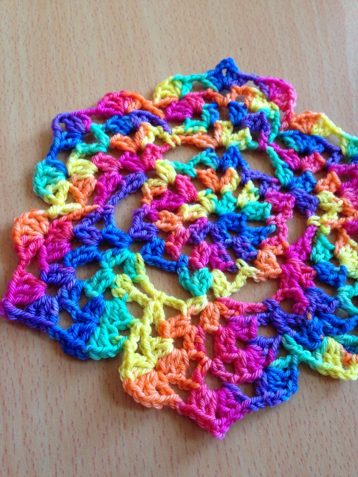 Doily crocheted from a chart with hand dyed sock yarn