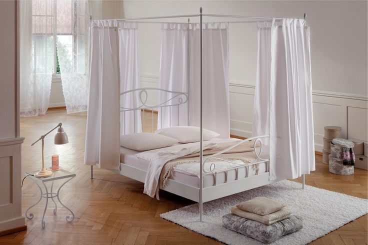 Extraordinary Canopy Bed Drapes For Cozy Bedding Design: Gorgeous White Furniture Bedroom With White Lacquer Iron Canopy Bed Drapes Using White Curtain Combined With White Rug Placed On Herringbone Hardwood Floor And White Wall Paint Bedroom Decor