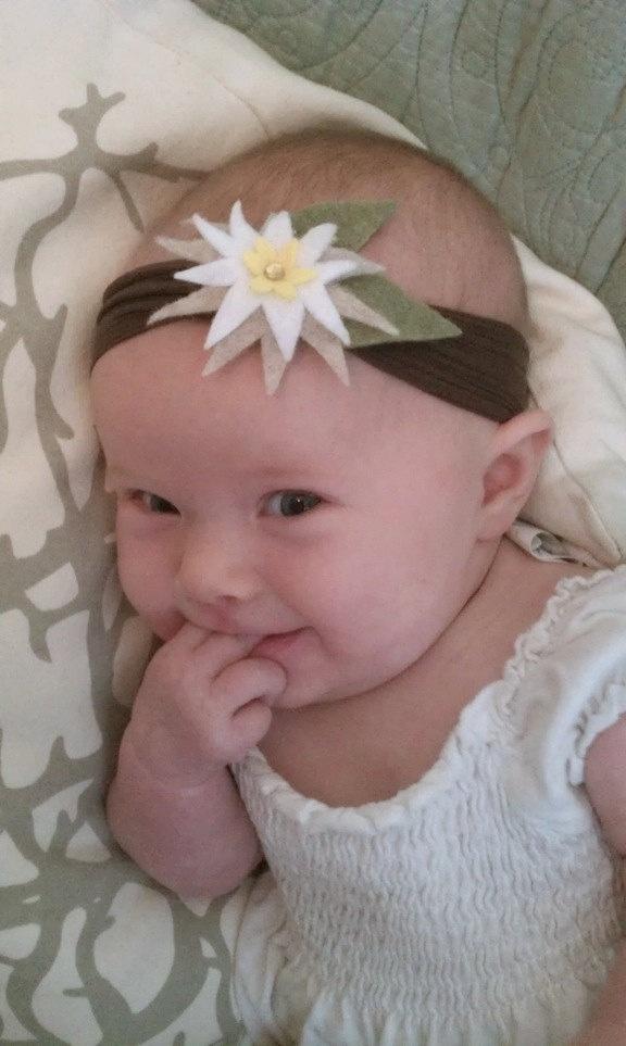 Edelweiss flower Headband, handmade with vegan materials & recycled felt (baby-adult sizes). $10.50, via Etsy.