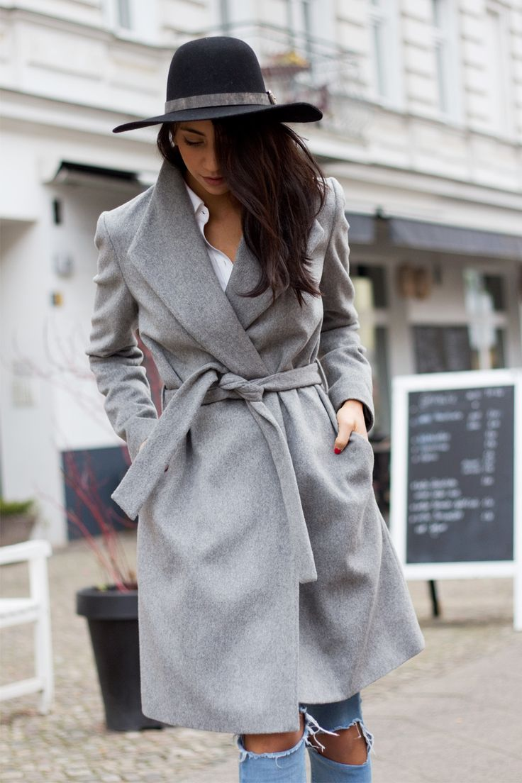 Kayla Seah is wearing a grey belted wool coat from Hallhuber