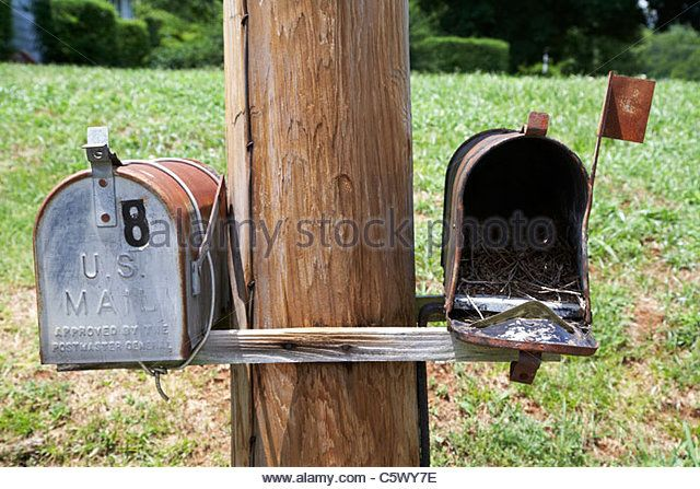 empty old used american private mailboxes one with birdsnest in Lynchburg , tennessee , usa - Stock Image