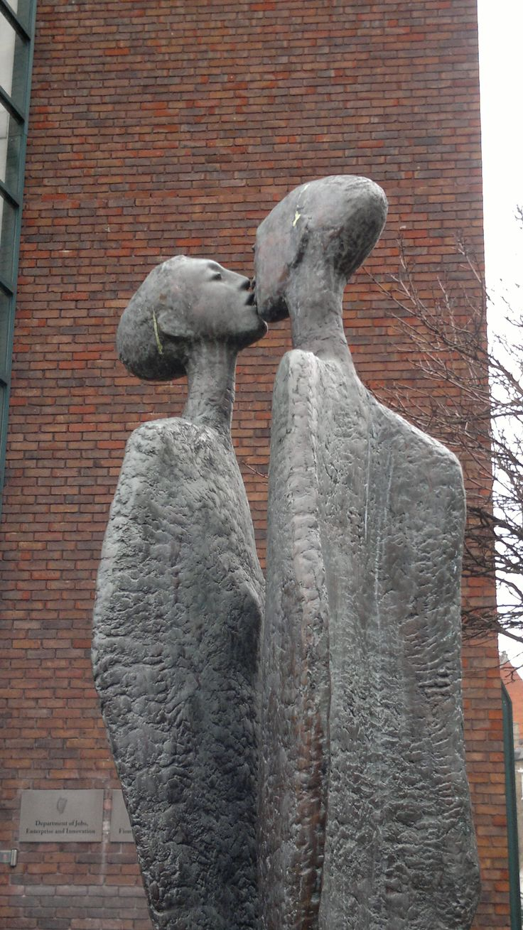 The Kiss, statue by Rowan Gillespie, 1989, Dublin, Ireland. The statue is…