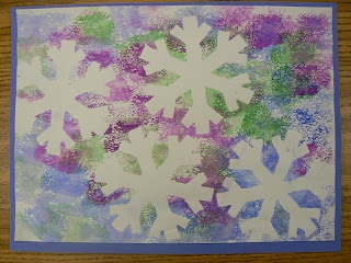 Put snowfrlake die cuts on a pice of white construction paper and then sponge paint over the top. When finished, remove snowflakes.