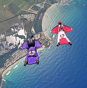 """""""Wingsuit flying"""".... I call them squirrel suits. And I want to jump off or out of something and use one. *nods*"""