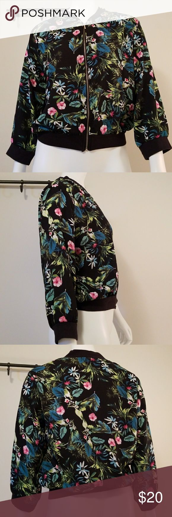 "Style House Sheer Floral Zip Up In excellent condition. Beautiful floral print. Black sweatshirt material (cotton) on collar, cuffs, and bottom hem. Long sleeve zip up.   Approximate measurements:  Length - 19""  Size S Style House Tops Tees - Long Sleeve"