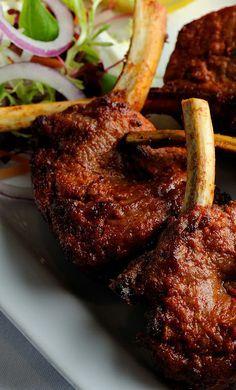 Peshwari lamb kebab - Alfred Prasad. This delightful lamb kebab recipe features grilled lamb chops marinated with raw papaya, garlic, ground chilli, fennel and cream.