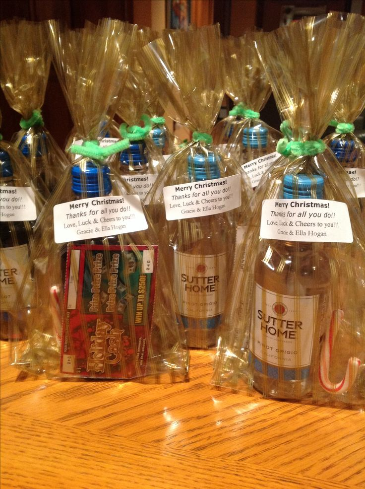 Christmas gifts for the school staff!  And, all under $3.00 each!  Wow!        Wine, scratch ticket and a candy cane!