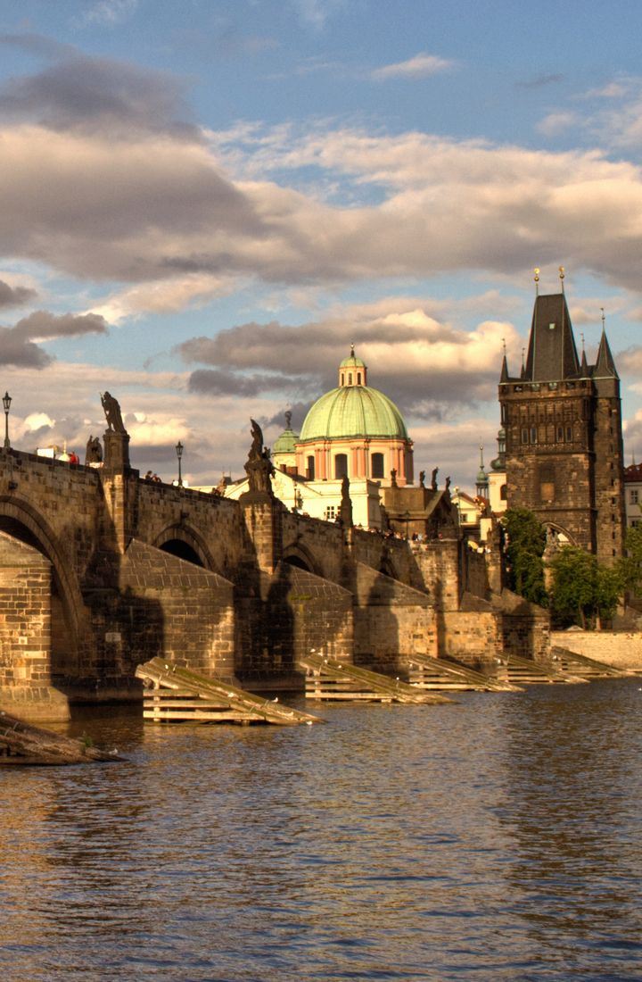 Crossing the Charles Bridge – or Karlův Most – in Prague, across the Vltava River, one of the most recognisable and popular sites in Prague.
