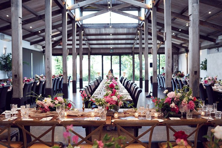 The Barn reception room #wedding #reception #setting #flowers #pink #exposedbeams #wood #rustic #charm