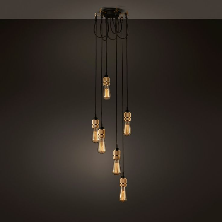 A chandelier made up of six light pendants, all with their own customising Hooks. The brass Hooks are housed in a rubber ceiling rose and allow the light to be