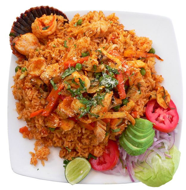 Check out these awesome looking Peruvian dishes! Pictured here is arroz con mariscos. - Buzzfeed