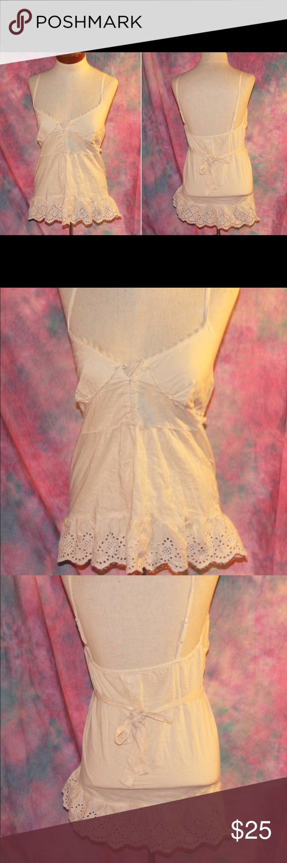 Cream tan beige vintage style cami eyelet lace top This one of a kind camisole is a must have this season. Features lace trimming. Eyelet design at hem, adjustable straps, top front button closure, empire waistline, attached waist tie. Never worn. Tops Camisoles