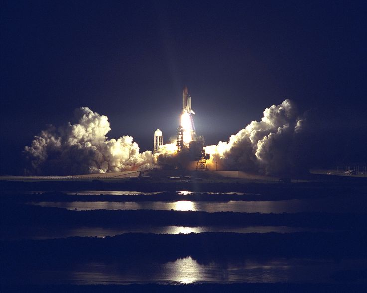 The Space Shuttle Atlantis blazes through the night sky to begin the STS-86 mission slated to be the seventh of nine planned dockings of the Space Shuttle with the Russian Space Station Mir. Liftoff on September 25 from Launch Pad 39A at 10:34 p.m. EDT [3000 x 2400]