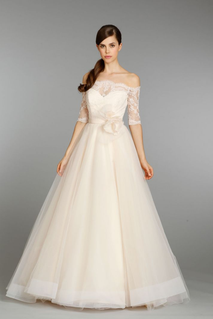 A very subtle blush bridal gown with off the shoulder lace sleeves from @Tara_Keely