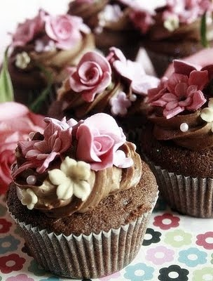Pink & white flowers wrapped around decadent chocolate frosting on chocolate cupcake. (could use heart/Valentine cupcake liners for Valentine's Day)