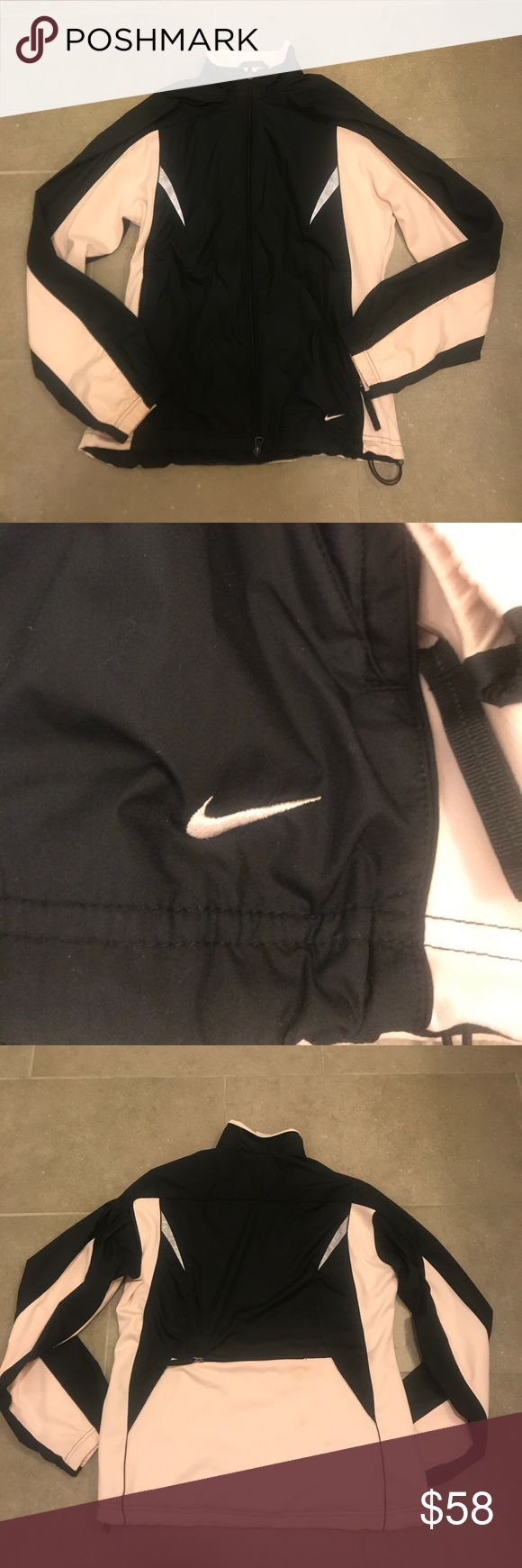 Nike Waterproof Jacket Nike Waterproof Jacket; Black and Light Pink; Long Sleeves; Zip Front Closure; Reflective Detail on Front and Back; Pockets; Zip Pocket Feature in Back; Drawstring Closure at Hem; Lined; Excellent Condition Nike Jackets & Coats