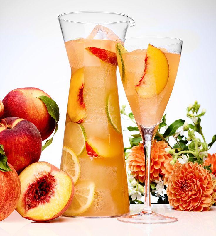 Peach Sangria.  To make a single cocktail: 1 oz peach-flavored vodka (such as CÎROC Peach), 0.5 oz Hennessy, 0.5 oz fresh lime juice, 0.5 oz fresh lemon juice, 0.5 oz simple syrup, 4 dashes bitters, 2 oz club soda, Stir over ice in wine glass.