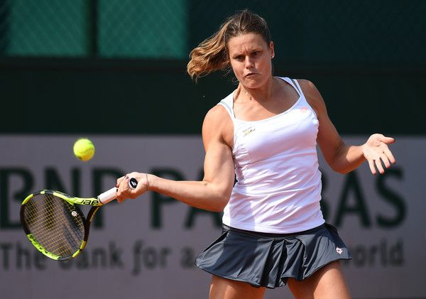 Karin Knapp Photos Photos - Karin Knapp of Italy hits a forehand during the Ladies Singles third round match against Yulia Putintseva of Kazakhstan on day seven of the 2016 French Open at Roland Garros on May 28, 2016 in Paris, France. - 2016 French Open - Day Seven