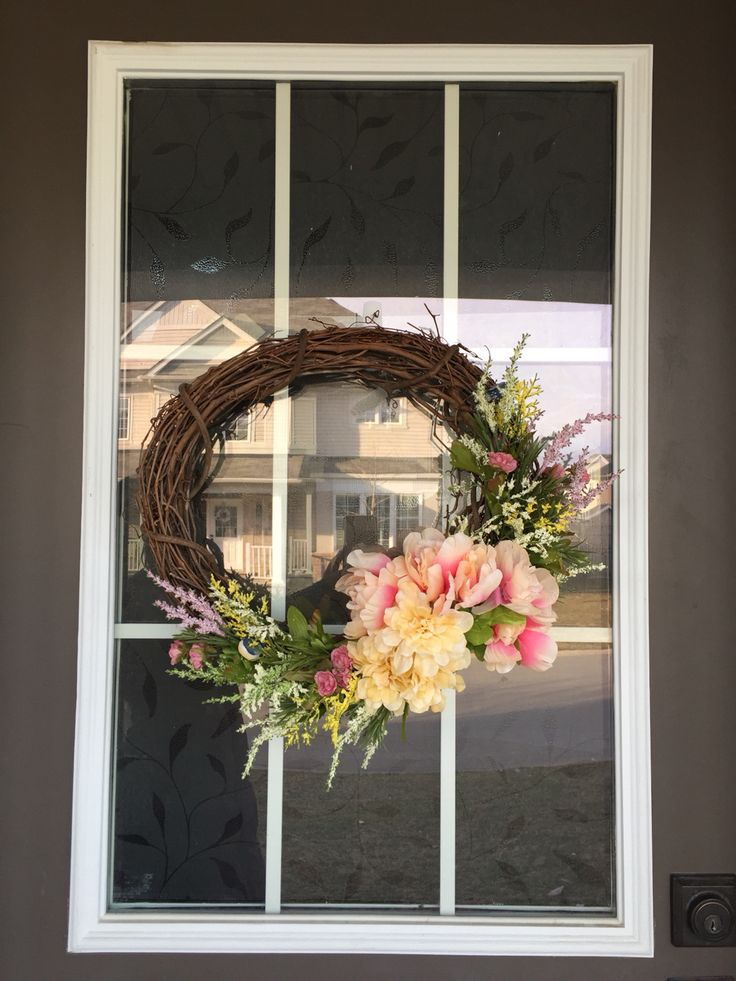 Spring wreath using sticks and dollarstore flowers. There's a couple of hidden fake birds in there too :)