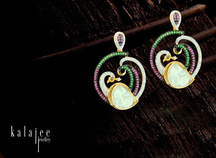 This dangling pair of #dancing peacock earrings is sure to win hearts.#earrings #diamonds #jewelry #Jaipur