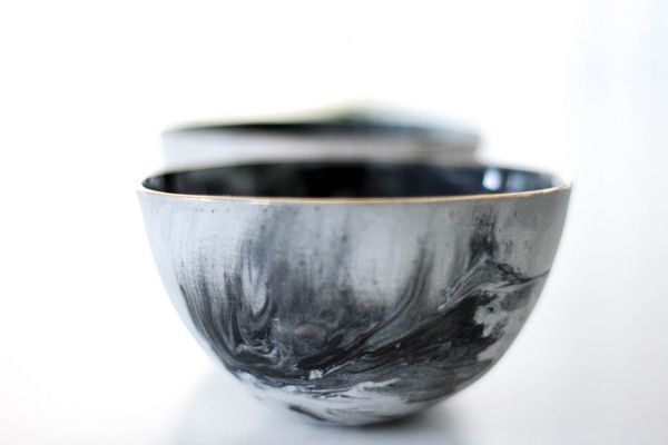 $43.00 HAUTEEDIT.COM - Set of 2 Porcelain Oil and Balsamic Bowls - Marble. The Porcelain Condiment Serving Set includes two elegant bowls that are ideal for serving condiments, sauces and dips to your guests. The grey marble design with gold lustre on rim gives this South African piece a contemporary feel. These limited edition pieces will make a serious statement in any home.