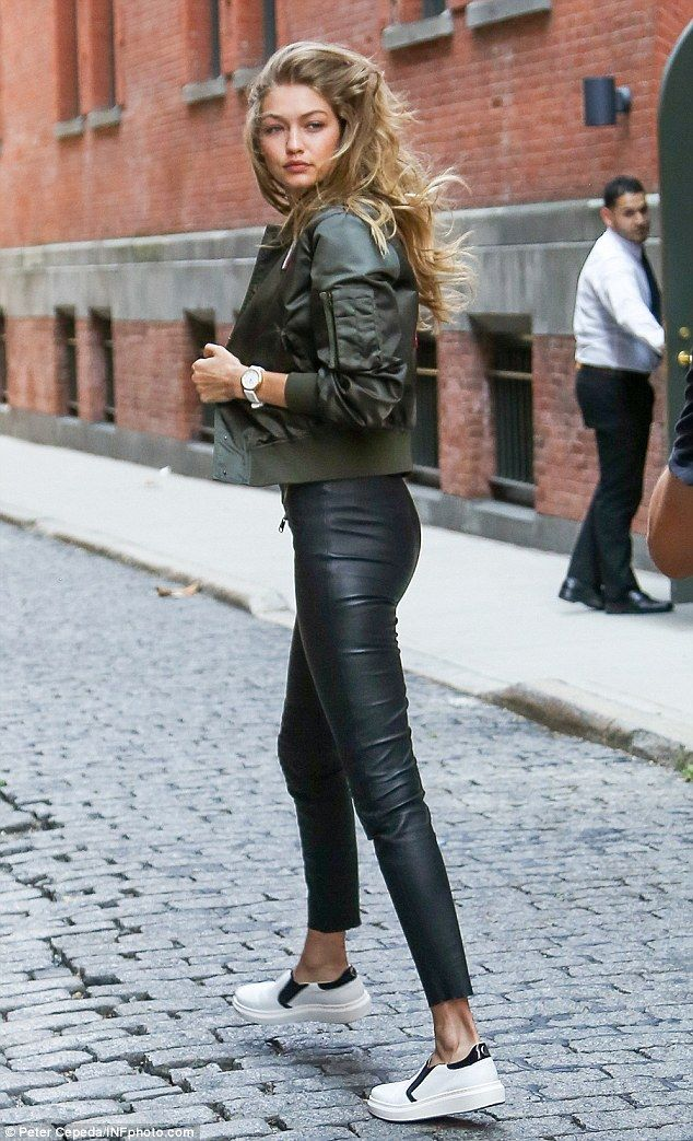 Casual cool:She completed the look with leather capri trousers along with white and black...
