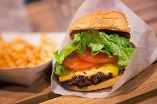CHICAGO, IL - JANUARY 28:  In this photo illustration a cheeseburger and french fries are served up at a Shake Shack restaurant on January 28, 2015 in Chicago, Illinois. The burger chain, with currently has 63 locations, is expected to go public this week with an IPO priced between $17 to $19 a share. The company will trade on the New York Stock Exchange under the ticker symbol SHAK.  (Photo Illustration by Scott Olson/Getty Images) Photo: Scott Olson, Getty Images